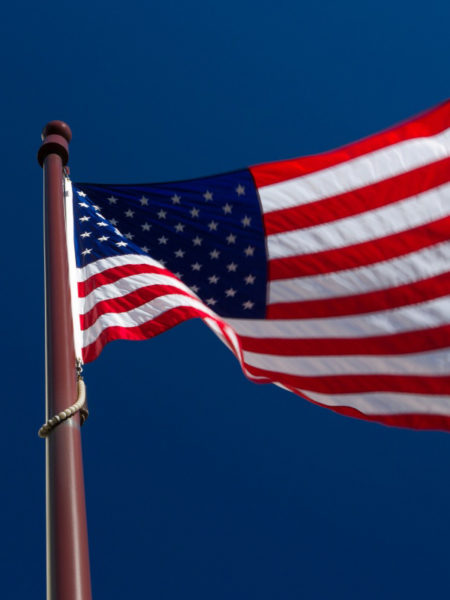 american flag and city buildings economic future construction costs